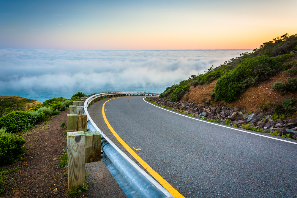 Road and view of fog over the San Francisco Bay, Golden Gate National Recreation Area, in San Francisco, California.