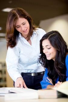 Teacher explaining the subject to a female student-1