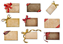 collection of various note cards with ribbon bow on white background. each one is shot separately